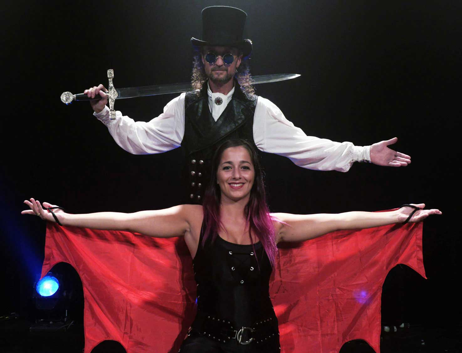 Loran the illusionist performing a magic show on stage with Kristel